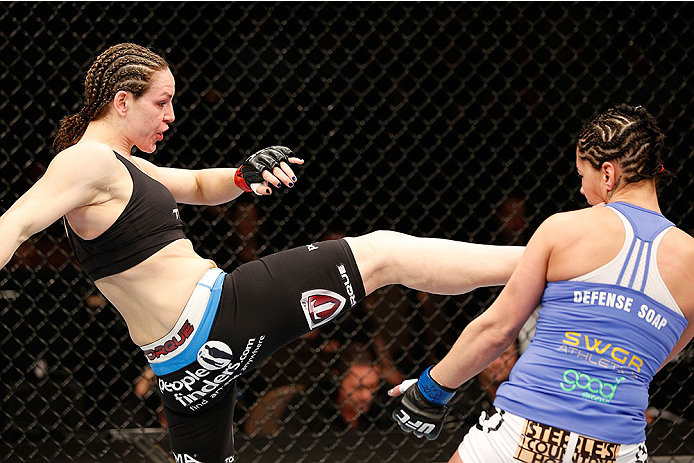 LAS VEGAS, NV - FEBRUARY 22:  (L-R) Alexis Davis kicks Jessica Eye in their women's bantamweight bout during UFC 170 inside the Mandalay Bay Events Center on February 22, 2014 in Las Vegas, Nevada. (Photo by Josh Hedges/Zuffa LLC/Zuffa LLC via Getty Images) *** Local Caption *** Alexis Davis; Jessica Eye