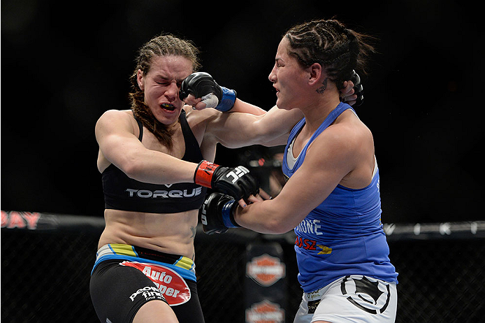 LAS VEGAS, NV - FEBRUARY 22:  (R-L) Jessica Eye punches Alexis Davis in their women's bantamweight bout during UFC 170 inside the Mandalay Bay Events Center on February 22, 2014 in Las Vegas, Nevada. (Photo by Jeff Bottari/Zuffa LLC/Zuffa LLC via Getty Images) *** Local Caption *** Alexis Davis; Jessica Eye