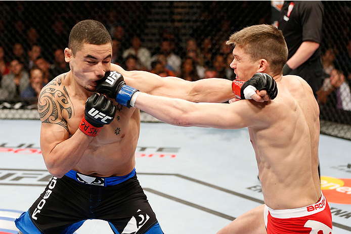 LAS VEGAS, NV - FEBRUARY 22:  (R-L) Stephen Thompson punches Robert Whittaker in their welterweight bout during UFC 170 inside the Mandalay Bay Events Center on February 22, 2014 in Las Vegas, Nevada. (Photo by Josh Hedges/Zuffa LLC/Zuffa LLC via Getty Images) *** Local Caption *** Robert Whittaker; Stephen Thompson