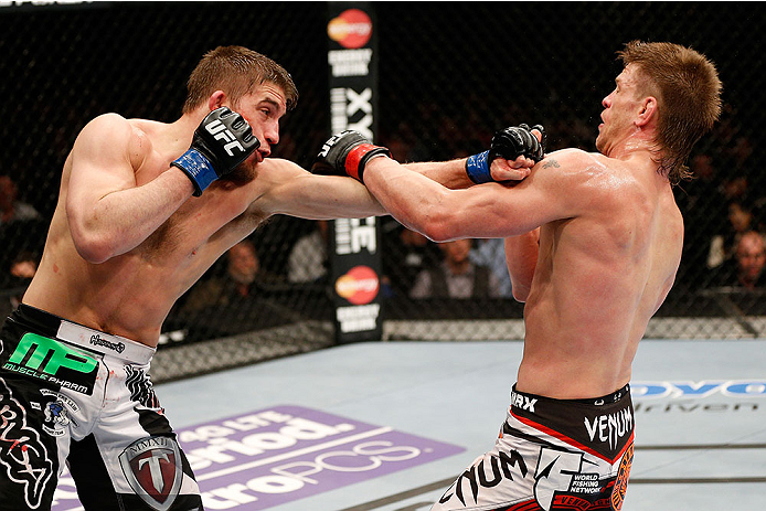 LAS VEGAS, NV - FEBRUARY 22:  (L-R) TJ Waldburger punches Mike Pyle in their welterweight bout during UFC 170 inside the Mandalay Bay Events Center on February 22, 2014 in Las Vegas, Nevada. (Photo by Josh Hedges/Zuffa LLC/Zuffa LLC via Getty Images) *** Local Caption *** Mike Pyle; TJ Waldburger