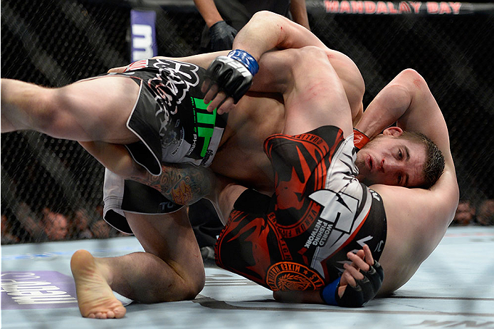 LAS VEGAS, NV - FEBRUARY 22:  Mike Pyle (bottom) attempts to submit TJ Waldburger in their welterweight bout during UFC 170 inside the Mandalay Bay Events Center on February 22, 2014 in Las Vegas, Nevada. (Photo by Jeff Bottari/Zuffa LLC/Zuffa LLC via Getty Images) *** Local Caption *** Mike Pyle; TJ Waldburger