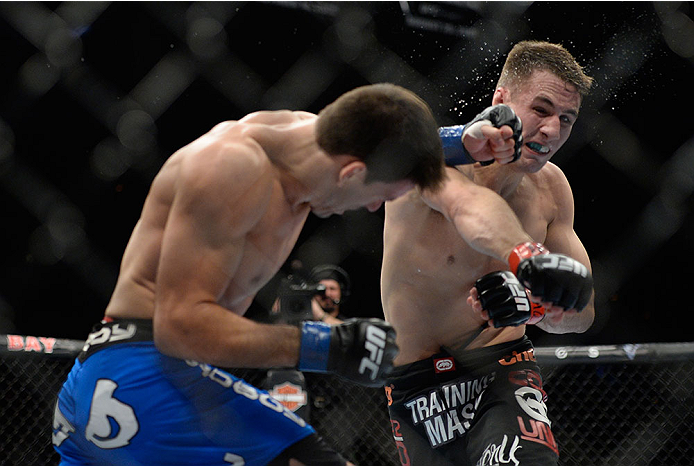 LAS VEGAS, NV - FEBRUARY 22:  (L-R) Demian Maia punches Rory MacDonald in their welterweight bout during UFC 170 inside the Mandalay Bay Events Center on February 22, 2014 in Las Vegas, Nevada. (Photo by Jeff Bottari/Zuffa LLC/Zuffa LLC via Getty Images) *** Local Caption *** Rory MacDonald; Demian Maia