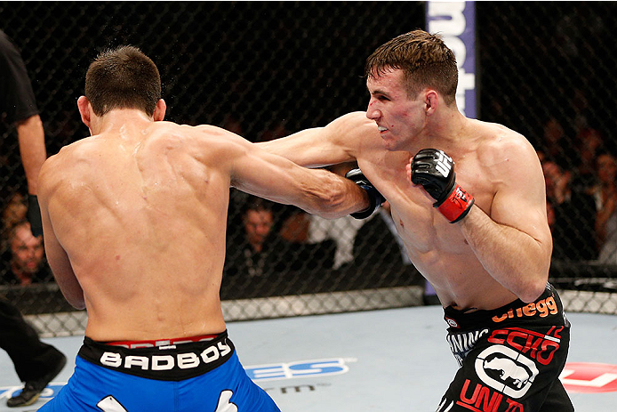 LAS VEGAS, NV - FEBRUARY 22:  (R-L) Rory MacDonald punches Demian Maia in their welterweight bout during UFC 170 inside the Mandalay Bay Events Center on February 22, 2014 in Las Vegas, Nevada. (Photo by Josh Hedges/Zuffa LLC/Zuffa LLC via Getty Images) *** Local Caption *** Rory MacDonald; Demian Maia