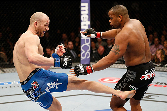 LAS VEGAS, NV - FEBRUARY 22:  (L-R) Patrick Cummins kicks Daniel Cormier in their light heavyweight bout during UFC 170 inside the Mandalay Bay Events Center on February 22, 2014 in Las Vegas, Nevada. (Photo by Josh Hedges/Zuffa LLC/Zuffa LLC via Getty Images) *** Local Caption *** Daniel Cormier; Patrick Cummins