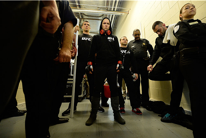 LAS VEGAS, NV - FEBRUARY 22:  Ronda Rousey (center) prepares to face Sara McMann in their women's bantamweight championship bout during UFC 170 inside the Mandalay Bay Events Center on February 22, 2014 in Las Vegas, Nevada. (Photo by Jeff Bottari/Zuffa LLC/Zuffa LLC via Getty Images) *** Local Caption *** Ronda Rousey