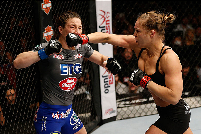 LAS VEGAS, NV - FEBRUARY 22:  (R-L) Ronda Rousey punches Sara McMann in their women's bantamweight championship bout during UFC 170 inside the Mandalay Bay Events Center on February 22, 2014 in Las Vegas, Nevada. (Photo by Josh Hedges/Zuffa LLC/Zuffa LLC via Getty Images) *** Local Caption *** Ronda Rousey; Sara McMann