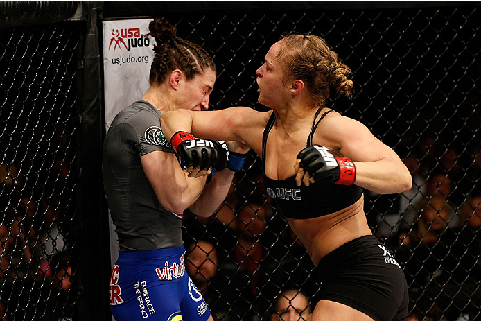 LAS VEGAS, NV - FEBRUARY 22:  Ronda Rousey (right) elbows Sara McMann in their women's bantamweight championship bout during UFC 170 inside the Mandalay Bay Events Center on February 22, 2014 in Las Vegas, Nevada. (Photo by Josh Hedges/Zuffa LLC/Zuffa LLC via Getty Images) *** Local Caption *** Ronda Rousey; Sara McMann
