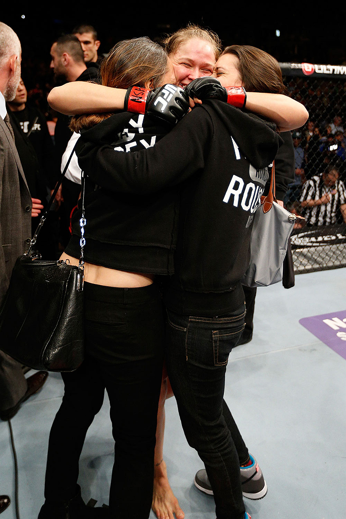 LAS VEGAS, NV - FEBRUARY 22:  Ronda Rousey (center) embraces her family after her victory over Sara McMann in their women's bantamweight championship bout during UFC 170 inside the Mandalay Bay Events Center on February 22, 2014 in Las Vegas, Nevada. (Photo by Josh Hedges/Zuffa LLC/Zuffa LLC via Getty Images) *** Local Caption *** Ronda Rousey