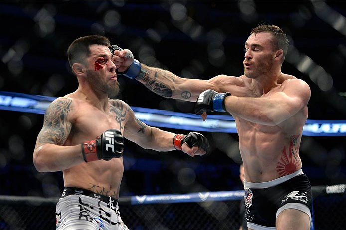 Robert Whiteford punches Daniel Pineda in their featherweight fight during the UFC 171 event inside American Airlines Center on March 15, 2014 in Dallas, Texas. (Photo by Jeff Bottari/Zuffa LLC)