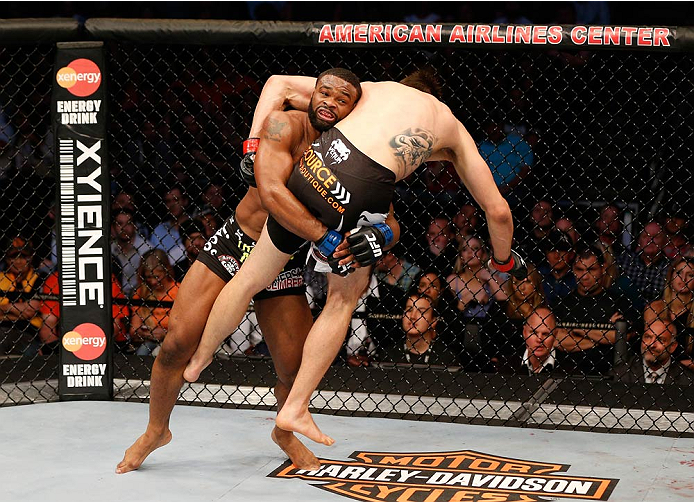 DALLAS, TX - MARCH 15:  (L-R) Tyron Woodley takes down Carlos Condit in their welterweight bout at UFC 171 inside American Airlines Center on March 15, 2014 in Dallas, Texas. (Photo by Josh Hedges/Zuffa LLC/Zuffa LLC via Getty Images)