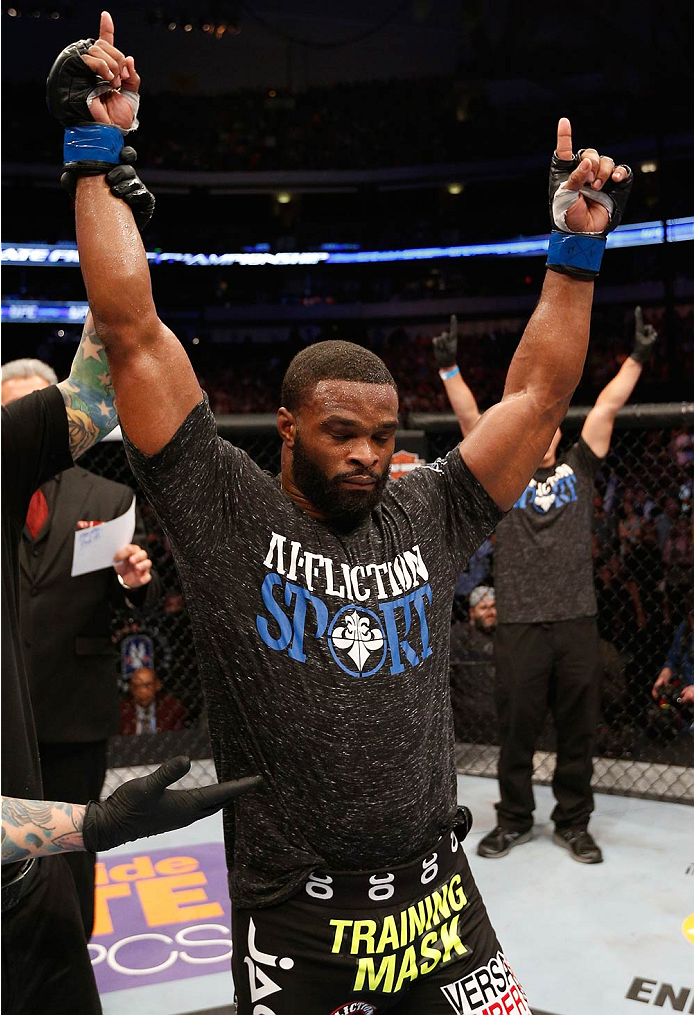 DALLAS, TX - MARCH 15:  Tyron Woodley reacts after defeating Carlos Condit in their welterweight bout at UFC 171 inside American Airlines Center on March 15, 2014 in Dallas, Texas. (Photo by Josh Hedges/Zuffa LLC/Zuffa LLC via Getty Images)