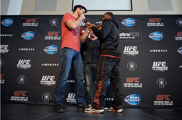 DALLAS, TX - MARCH 13:  (L-R) Carlos Condit and Tyron Woodley square off for the media during the UFC 171 Ultimate Media Day at American Airlines Center on March 13, 2014 in Dallas, Texas. (Photo by Jeff Bottari/Zuffa LLC/Zuffa LLC via Getty Images)