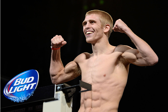 DALLAS, TX - MARCH 14:  Justin Scoggins steps on the scale during the UFC 171 weigh-in event at Gilley's Dallas on March 14, 2014 in Dallas, Texas. (Photo by Jeff Bottari/Zuffa LLC/Zuffa LLC via Getty Images)