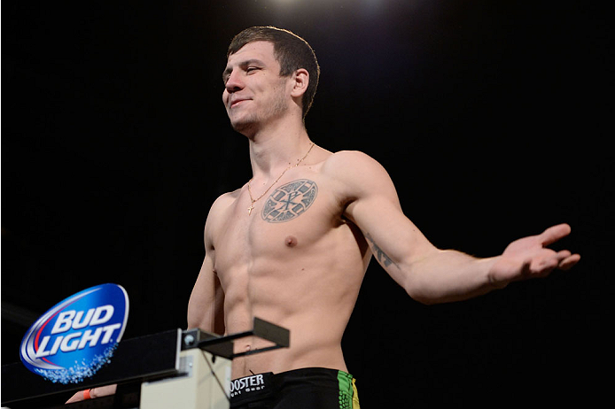 DALLAS, TX - MARCH 14:  Nikita Krylov steps on the scale during the UFC 171 weigh-in event at Gilley's Dallas on March 14, 2014 in Dallas, Texas. (Photo by Jeff Bottari/Zuffa LLC/Zuffa LLC via Getty Images)