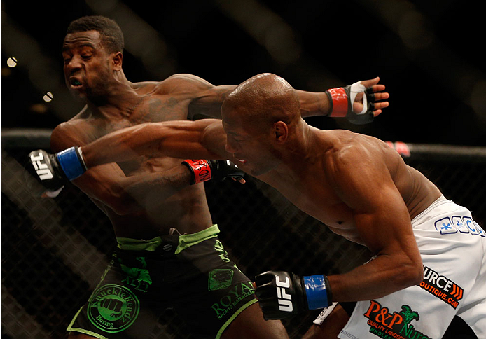 BALTIMORE, MD - APRIL 26:  (R-L) Patrick Williams punches Chris Beal in their bantamweight bout during the UFC 172 event at the Baltimore Arena on April 26, 2014 in Baltimore, Maryland. (Photo by Josh Hedges/Zuffa LLC/Zuffa LLC via Getty Images)