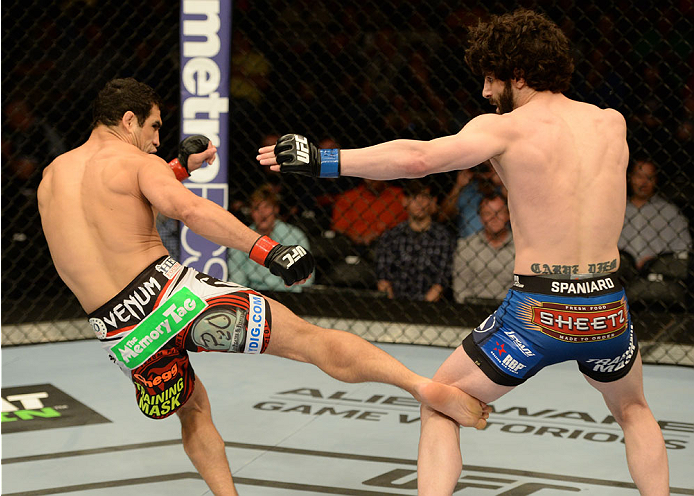 BALTIMORE, MD - APRIL 26:  (L-R) Danny Castillo kicks Charlie Brenneman in their lightweight bout during the UFC 172 event at the Baltimore Arena on April 26, 2014 in Baltimore, Maryland. (Photo by Patrick Smith/Zuffa LLC/Zuffa LLC via Getty Images)