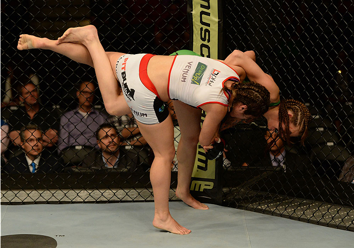 BALTIMORE, MD - APRIL 26:  (R-L) Jessamyn Duke attempts to throw Bethe Correia with a judo toss in their women's bantamweight bout during the UFC 172 event at the Baltimore Arena on April 26, 2014 in Baltimore, Maryland. (Photo by Patrick Smith/Zuffa LLC/Zuffa LLC via Getty Images)