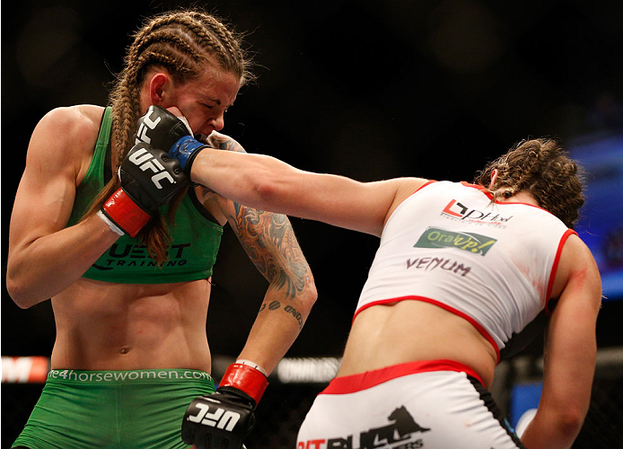 BALTIMORE, MD - APRIL 26:  (R-L) Bethe Correia punches Jessamyn Duke in their women's bantamweight bout during the UFC 172 event at the Baltimore Arena on April 26, 2014 in Baltimore, Maryland. (Photo by Josh Hedges/Zuffa LLC/Zuffa LLC via Getty Images)