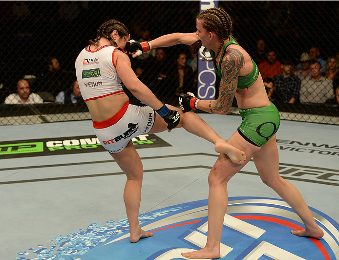 BALTIMORE, MD - APRIL 26:  (R-L) Jessamyn Duke and Bethe Correia trade strikes in their women's bantamweight bout during the UFC 172 event at the Baltimore Arena on April 26, 2014 in Baltimore, Maryland. (Photo by Patrick Smith/Zuffa LLC/Zuffa LLC via Getty Images)