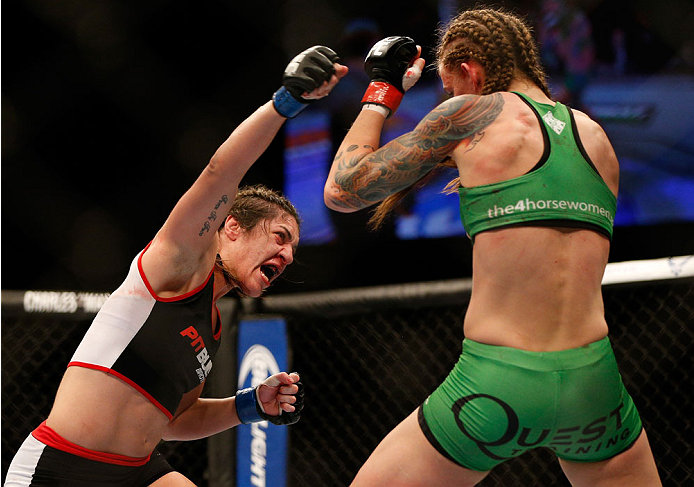 BALTIMORE, MD - APRIL 26:  (L-R) Bethe Correia punches Jessamyn Duke in their women's bantamweight bout during the UFC 172 event at the Baltimore Arena on April 26, 2014 in Baltimore, Maryland. (Photo by Josh Hedges/Zuffa LLC/Zuffa LLC via Getty Images)