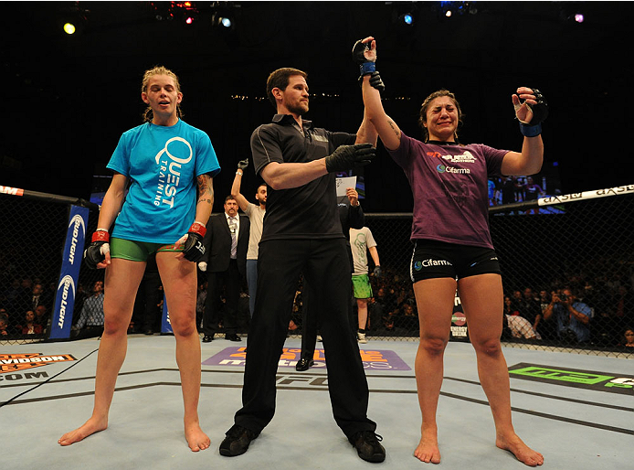BALTIMORE, MD - APRIL 26:  Bethe Correia (R) reacts after her decision victory over Jessamyn Duke in their women's bantamweight bout during the UFC 172 event at the Baltimore Arena on April 26, 2014 in Baltimore, Maryland. (Photo by Patrick Smith/Zuffa LLC/Zuffa LLC via Getty Images)