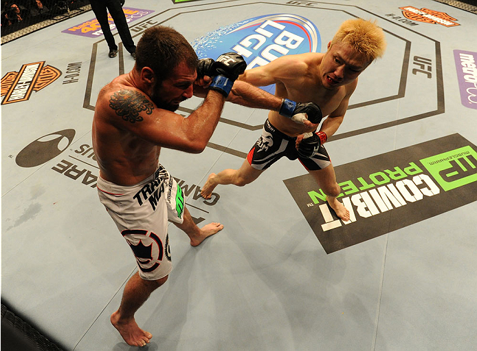BALTIMORE, MD - APRIL 26:  (R-L) Takanori Gomi punches Isaac Vallie-Flagg in their lightweight bout during the UFC 172 event at the Baltimore Arena on April 26, 2014 in Baltimore, Maryland. (Photo by Patrick Smith/Zuffa LLC/Zuffa LLC via Getty Images)