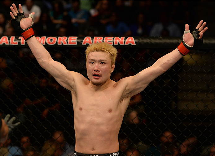 BALTIMORE, MD - APRIL 26:  Takanori Gomi reacts to the crowd's applause before the third round of his lightweight bout against Isaac Vallie-Flagg during the UFC 172 event at the Baltimore Arena on April 26, 2014 in Baltimore, Maryland. (Photo by Patrick Smith/Zuffa LLC/Zuffa LLC via Getty Images)