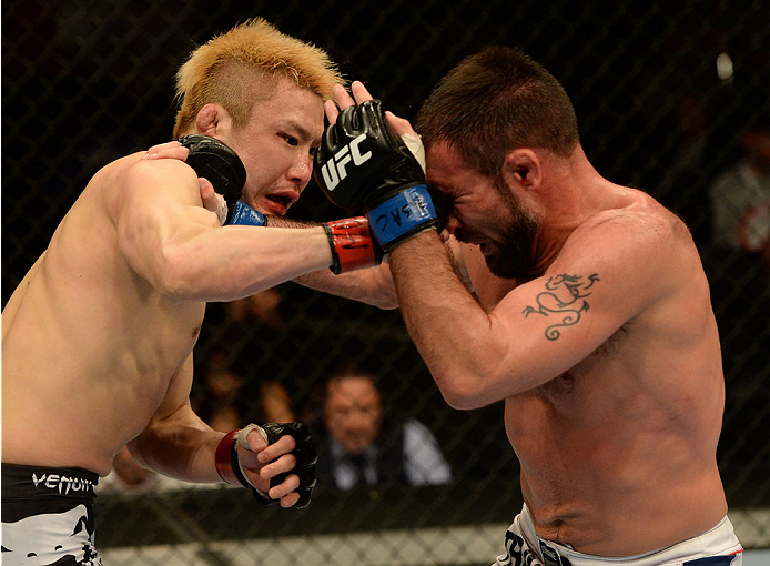 BALTIMORE, MD - APRIL 26:  (L-R) Takanori Gomi punches Isaac Vallie-Flagg in their lightweight bout during the UFC 172 event at the Baltimore Arena on April 26, 2014 in Baltimore, Maryland. (Photo by Patrick Smith/Zuffa LLC/Zuffa LLC via Getty Images)