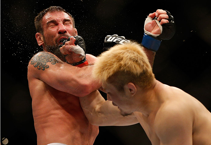 BALTIMORE, MD - APRIL 26:  (R-L) Takanori Gomi punches Isaac Vallie-Flagg in their lightweight bout during the UFC 172 event at the Baltimore Arena on April 26, 2014 in Baltimore, Maryland. (Photo by Josh Hedges/Zuffa LLC/Zuffa LLC via Getty Images)