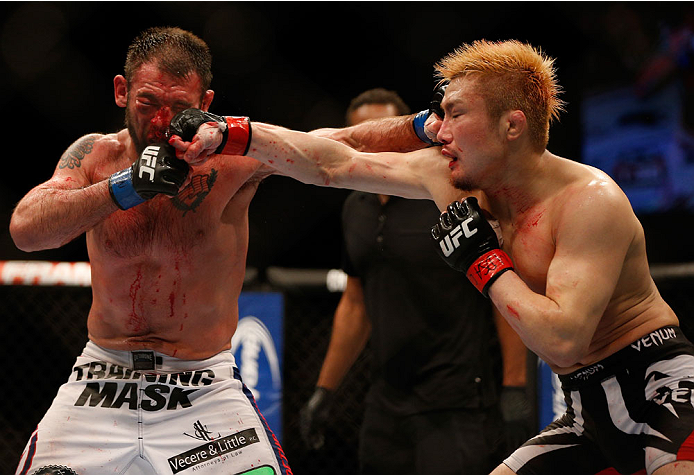 BALTIMORE, MD - APRIL 26: (R-L) Takanori Gomi and Isaac Vallie-Flagg trade punches in their lightweight bout during the UFC 172 event at the Baltimore Arena on April 26, 2014 in Baltimore, Maryland. (Photo by Josh Hedges/Zuffa LLC/Zuffa LLC via Getty Images)