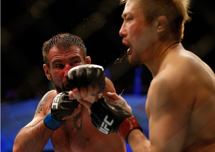 BALTIMORE, MD - APRIL 26:  (L-R) Isaac Vallie-Flagg punches Takanori Gomi in their lightweight bout during the UFC 172 event at the Baltimore Arena on April 26, 2014 in Baltimore, Maryland. (Photo by Josh Hedges/Zuffa LLC/Zuffa LLC via Getty Images)