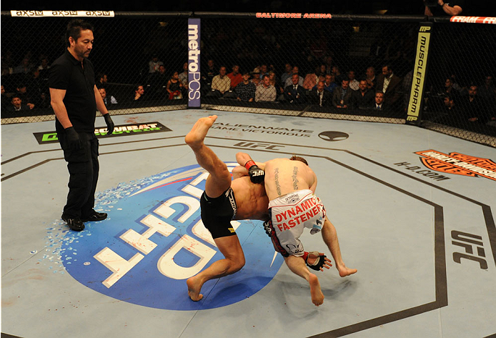 BALTIMORE, MD - APRIL 26:  (R-L) Timothy Elliott throws Joseph Benavidez to the canvas in their bantamweight bout during the UFC 172 event at the Baltimore Arena on April 26, 2014 in Baltimore, Maryland. (Photo by Patrick Smith/Zuffa LLC/Zuffa LLC via Getty Images)