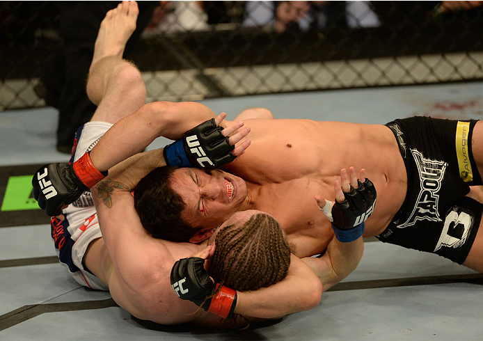BALTIMORE, MD - APRIL 26:  (R-L) Joseph Benavidez struggles to escape a crucifix position against opponent Timothy Elliott in their bantamweight bout during the UFC 172 event at the Baltimore Arena on April 26, 2014 in Baltimore, Maryland. (Photo by Patrick Smith/Zuffa LLC/Zuffa LLC via Getty Images)