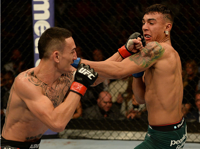 BALTIMORE, MD - APRIL 26:  (L-R) Max Holloway and Andre Fili trade punches in their featherweight bout during the UFC 172 event at the Baltimore Arena on April 26, 2014 in Baltimore, Maryland. (Photo by Patrick Smith/Zuffa LLC/Zuffa LLC via Getty Images)