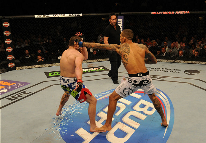 BALTIMORE, MD - APRIL 26:  (R-L) Yancy Medeiros punches Jim Miller in their lightweight bout during the UFC 172 event at the Baltimore Arena on April 26, 2014 in Baltimore, Maryland. (Photo by Patrick Smith/Zuffa LLC/Zuffa LLC via Getty Images)