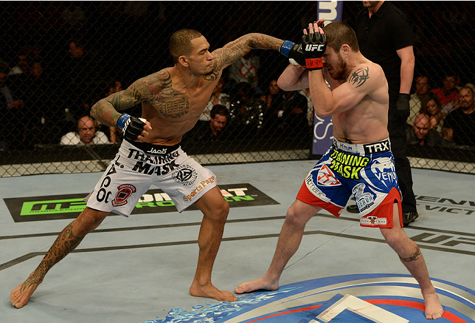 BALTIMORE, MD - APRIL 26:  (L-R) Yancy Medeiros punches Jim Miller in their lightweight bout during the UFC 172 event at the Baltimore Arena on April 26, 2014 in Baltimore, Maryland. (Photo by Patrick Smith/Zuffa LLC/Zuffa LLC via Getty Images)