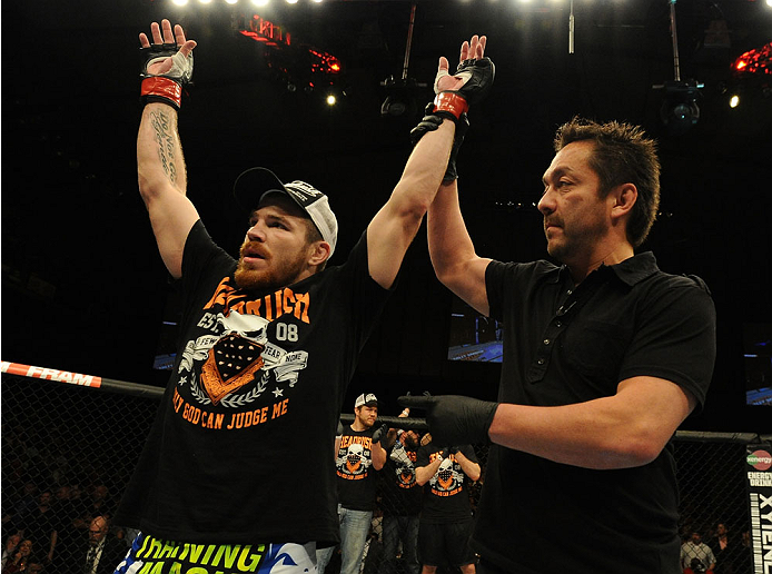 BALTIMORE, MD - APRIL 26:  Jim Miller reacts after his submission victory over Yancy Medeiros in their lightweight bout during the UFC 172 event at the Baltimore Arena on April 26, 2014 in Baltimore, Maryland. (Photo by Patrick Smith/Zuffa LLC/Zuffa LLC via Getty Images)