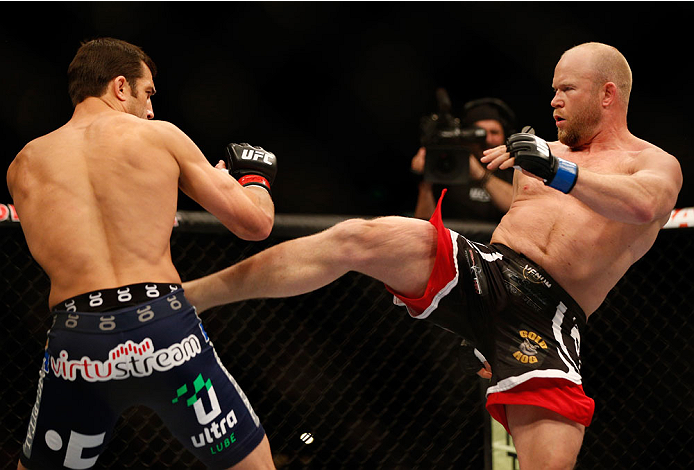 BALTIMORE, MD - APRIL 26:  (R-L) Tim Boetsch kicks Luke Rockhold in their middleweight bout during the UFC 172 event at the Baltimore Arena on April 26, 2014 in Baltimore, Maryland. (Photo by Josh Hedges/Zuffa LLC/Zuffa LLC via Getty Images)