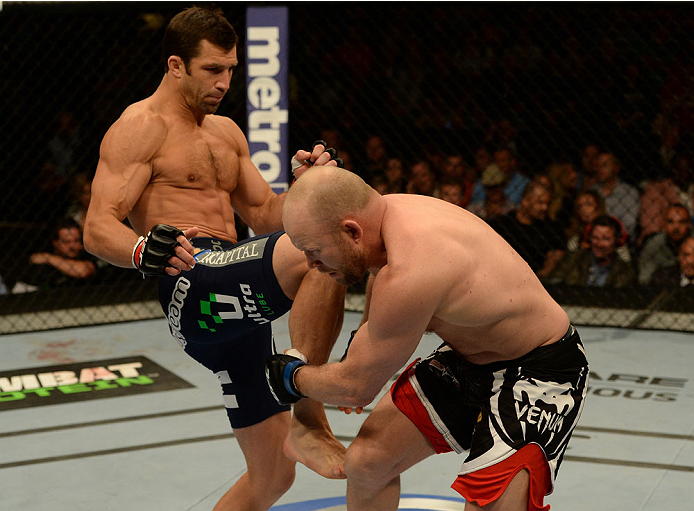 BALTIMORE, MD - APRIL 26:  (L-R) Luke Rockhold knees Tim Boetsch in their middleweight bout during the UFC 172 event at the Baltimore Arena on April 26, 2014 in Baltimore, Maryland. (Photo by Patrick Smith/Zuffa LLC/Zuffa LLC via Getty Images)