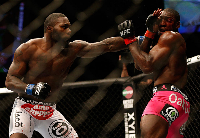 BALTIMORE, MD - APRIL 26:  (L-R) Anthony Johnson punches Phil Davis in their light heavyweight bout during the UFC 172 event at the Baltimore Arena on April 26, 2014 in Baltimore, Maryland. (Photo by Josh Hedges/Zuffa LLC/Zuffa LLC via Getty Images)