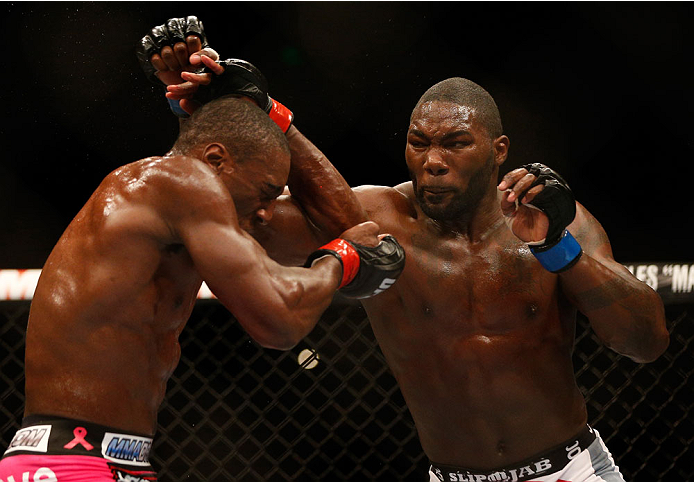 BALTIMORE, MD - APRIL 26:  (R-L) Anthony Johnson punches Phil Davis in their light heavyweight bout during the UFC 172 event at the Baltimore Arena on April 26, 2014 in Baltimore, Maryland. (Photo by Josh Hedges/Zuffa LLC/Zuffa LLC via Getty Images)