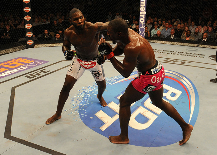 BALTIMORE, MD - APRIL 26:  (L-R) Anthony Johnson punches Phil Davis in their light heavyweight bout during the UFC 172 event at the Baltimore Arena on April 26, 2014 in Baltimore, Maryland. (Photo by Patrick Smith/Zuffa LLC/Zuffa LLC via Getty Images)