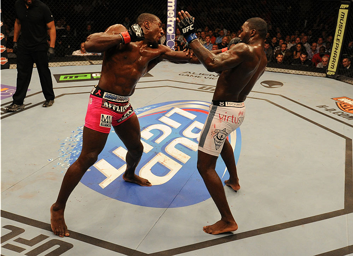 BALTIMORE, MD - APRIL 26:  (L-R) Phil Davis punches Anthony Johnson in their light heavyweight bout during the UFC 172 event at the Baltimore Arena on April 26, 2014 in Baltimore, Maryland. (Photo by Patrick Smith/Zuffa LLC/Zuffa LLC via Getty Images)