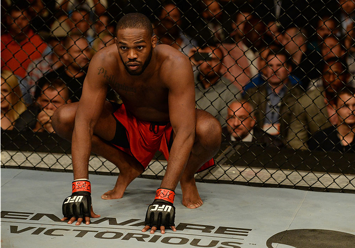 "BALTIMORE, MD - APRIL 26: Jon ""Bones"" Jones crouches in the Octagon before his light heavyweight championship bout against Glover Teixeira during the UFC 172 event at the Baltimore Arena on April 26, 2014 in Baltimore, Maryland. (Photo by Patrick Smith/Zuffa LLC/Zuffa LLC via Getty Images)"