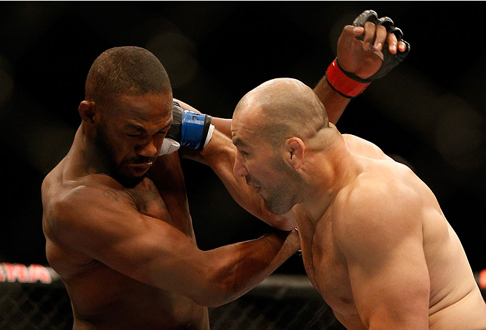 "BALTIMORE, MD - APRIL 26:  (R-L) Glover Teixeira punches Jon ""Bones"" Jones in their light heavyweight championship bout during the UFC 172 event at the Baltimore Arena on April 26, 2014 in Baltimore, Maryland. (Photo by Josh Hedges/Zuffa LLC/Zuffa LLC via Getty Images)"
