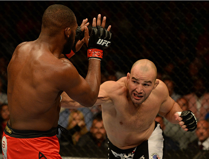 "BALTIMORE, MD - APRIL 26:  (R-L) Glover Teixeira punches Jon ""Bones"" Jones in their light heavyweight championship bout during the UFC 172 event at the Baltimore Arena on April 26, 2014 in Baltimore, Maryland. (Photo by Patrick Smith/Zuffa LLC/Zuffa LLC via Getty Images)"