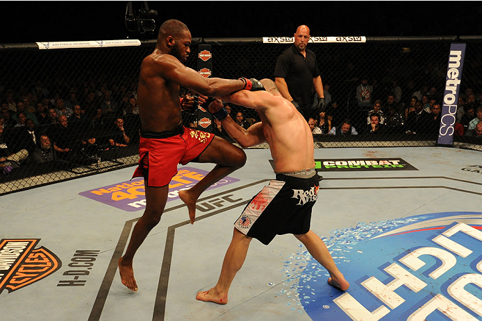 "BALTIMORE, MD - APRIL 26:  (L-R) Jon ""Bones"" Jones knees Glover Teixeira in their light heavyweight championship bout during the UFC 172 event at the Baltimore Arena on April 26, 2014 in Baltimore, Maryland. (Photo by Patrick Smith/Zuffa LLC/Zuffa LLC via Getty Images)"