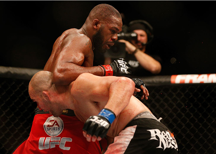 "BALTIMORE, MD - APRIL 26:  (L-R) Jon ""Bones"" Jones elbows Glover Teixeira in their light heavyweight championship bout during the UFC 172 event at the Baltimore Arena on April 26, 2014 in Baltimore, Maryland. (Photo by Josh Hedges/Zuffa LLC/Zuffa LLC via Getty Images)"