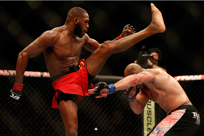"BALTIMORE, MD - APRIL 26:  (L-R) Jon ""Bones"" Jones kicks Glover Teixeira in their light heavyweight championship bout during the UFC 172 event at the Baltimore Arena on April 26, 2014 in Baltimore, Maryland. (Photo by Josh Hedges/Zuffa LLC/Zuffa LLC via Getty Images)"