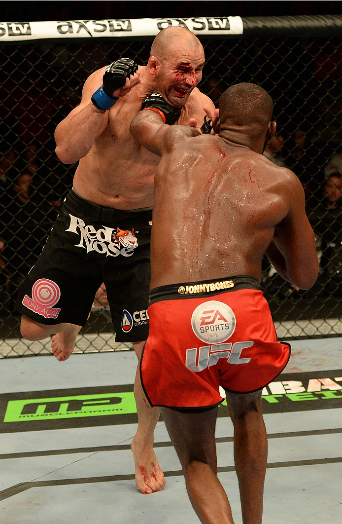 "BALTIMORE, MD - APRIL 26:  (R-L) Jon ""Bones"" Jones punches Glover Teixeira in their light heavyweight championship bout during the UFC 172 event at the Baltimore Arena on April 26, 2014 in Baltimore, Maryland. (Photo by Patrick Smith/Zuffa LLC/Zuffa LLC via Getty Images)"